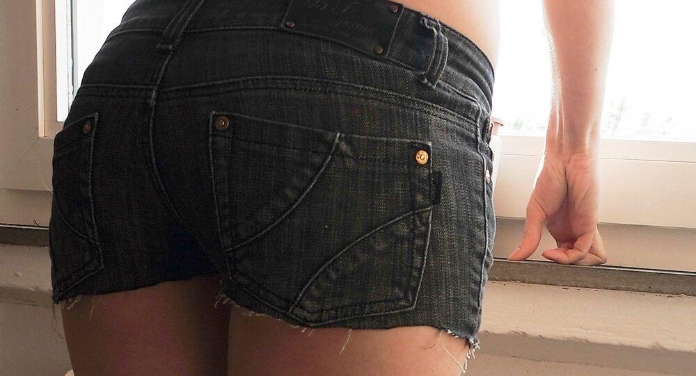 A woman wearing shorts