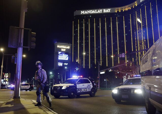 Police officers stand along the Las Vegas Strip near the Mandalay Bay resort and casino during a shooting at a country music festival, in Las Vegas. (File)
