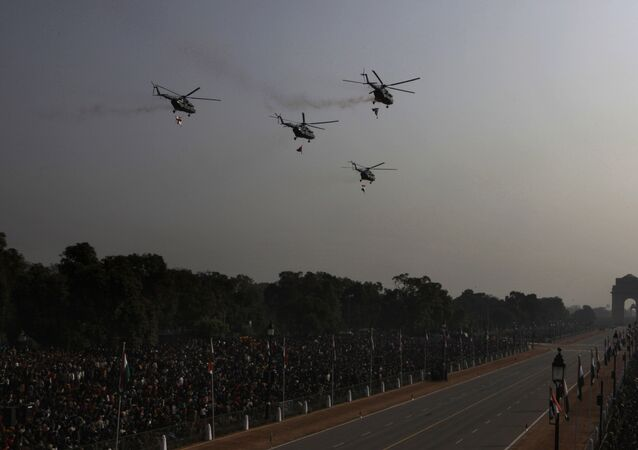 Mi-17 helicopters shower flower petals before the start of the Republic Day parade in New Delhi, India, Wednesday, Jan. 26, 2011