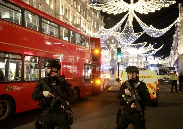 Armed police officersstand on Oxford Street, London, Britain November 24, 2017.