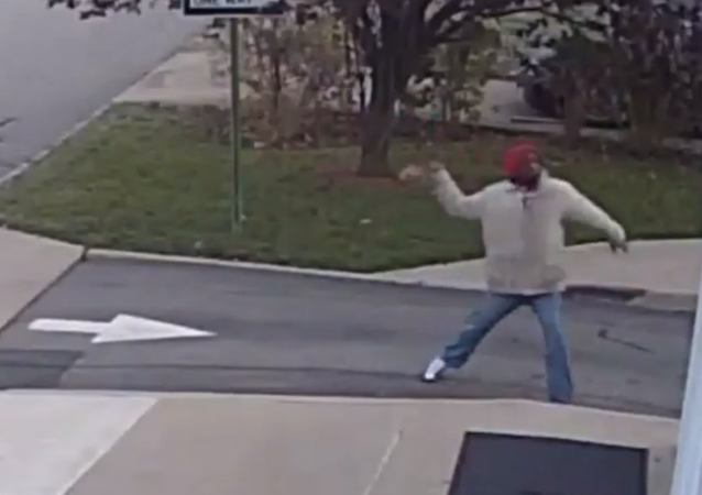 Zuri Towns is seen throwing rocks at the Morristown Church of Christ and Church of God in Christ for All Saints in the church's security footage