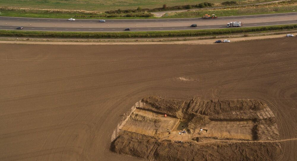 View of the University of Leicester excavations at Ebbsfleet in 2016 showing Pegwell Bay and the cliffs at Ramsgate