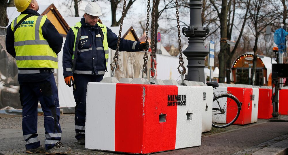 Workers install concrete barriers at the Christmas Market on Schloss Chartottenburg in Berlin, Germany, November 27, 2017