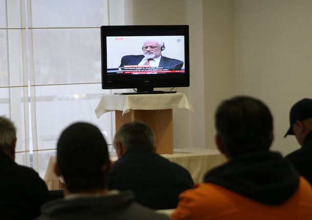 Slobodan Praljak is seen during television broadcast of the appeal trial in the Hague, Netherlands, for six Bosnian Croat senior wartime officials accused of war crimes against Muslims in Bosnia's 1992-1995 war, in Mostar, Bosnia and Herzegovina