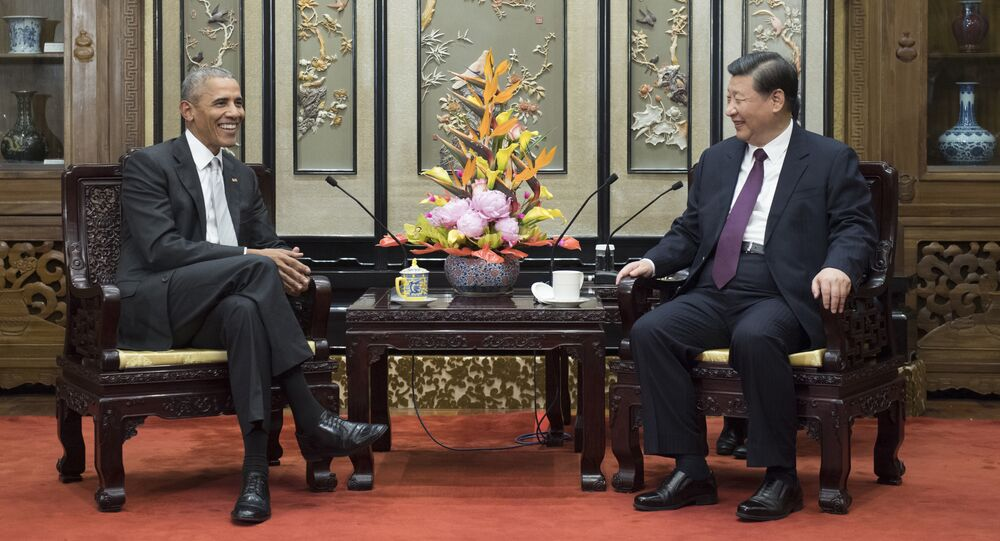 In this Wednesday, Nov. 29, 2017, photo released by China's Xinhua News Agency, former U.S. President Barack Obama, left, meets with Chinese President Xi Jinping at the Diaoyutai State Guesthouse in Beijing