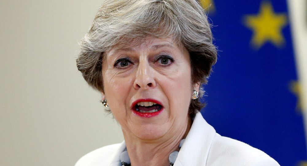 Britain's Prime Minister Theresa May addresses a news conference during an European Union leaders summit in Brussels, Belgium, October 20, 2017.