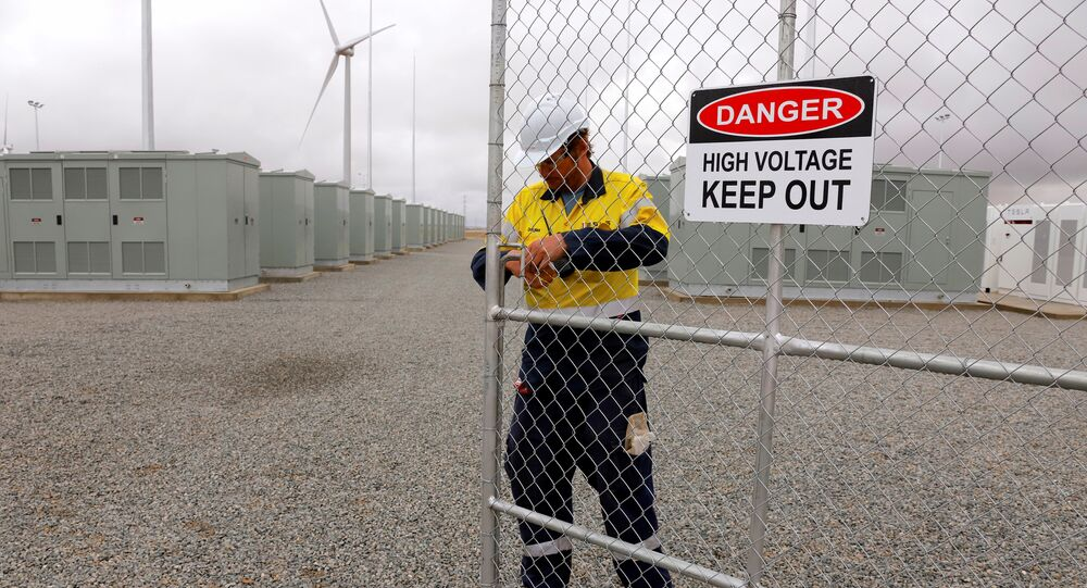 A worker checks the main gate for the compound housing the Hornsdale Power Reserve, featuring the world's largest lithium ion battery made by Tesla, during the official launch near the South Australian town of Jamestown, in Australia, December 1, 2017