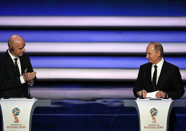 FIFA president Gianni Infantino, left, and Russian President Vladimir Putin open the 2018 soccer World Cup draw in the Kremlin in Moscow