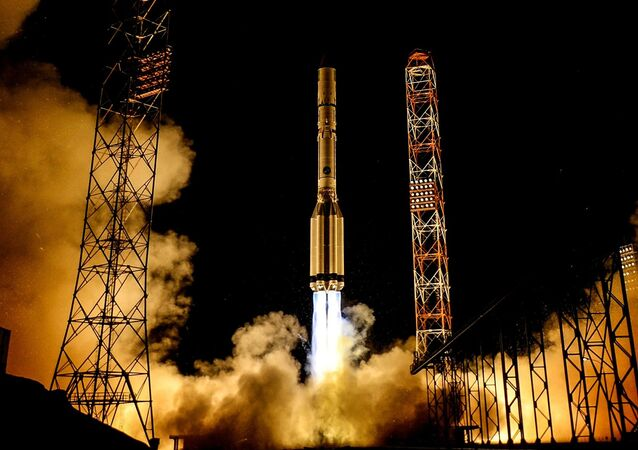The Spanish Amazonas-5 telecommunications satellite lifts off atop a Proton-M rocket from the Baikonur Space Center