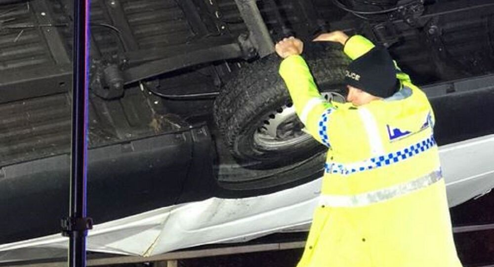 Man held onto the van to stop it toppling over a bridge