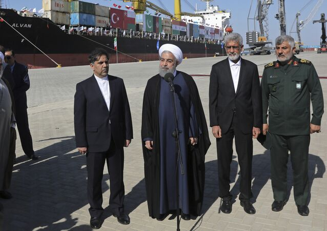 Iranian President Hassan Rouhani, center, speaks during the inauguration a newly built extension of the port of Chabahar, near the Pakistani border, on the Gulf of Oman, southeastern Iran, Sunday, Dec. 3, 2017