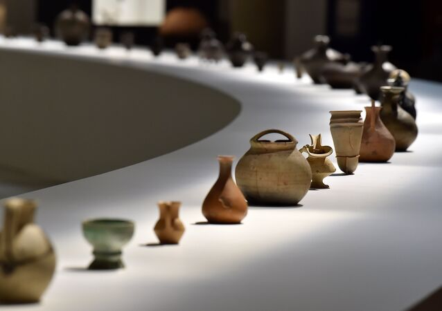 Georgian wine carafes dating from several different eras sit on display at an exhibition at The Cité du Vin in Bordeaux on July 28, 2017