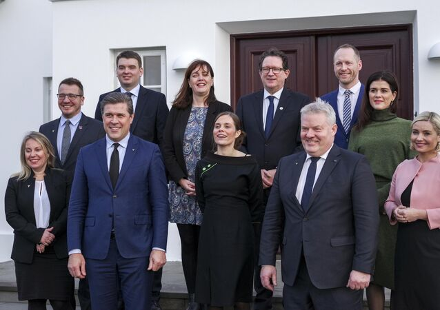 Iceland's new Prime Minister Katrin Jakobsdottir (C) with her government poses for media in Reykjavik, Iceland November 30, 2017