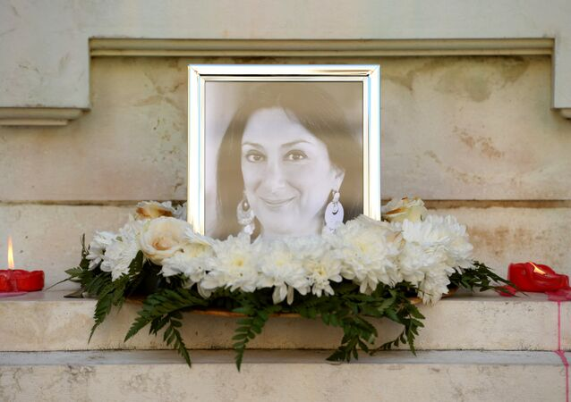Flowers and tributes lay at the foot of the Great Siege monument in Valletta, Malta, on October 19, 2017 which has been turned into a temporary shrine for Maltese journalist and blogger Daphne Caruana Galizia (picture) who was killed by a car bomb outside her home in Bidnjia, Malta, on October 16, 2017
