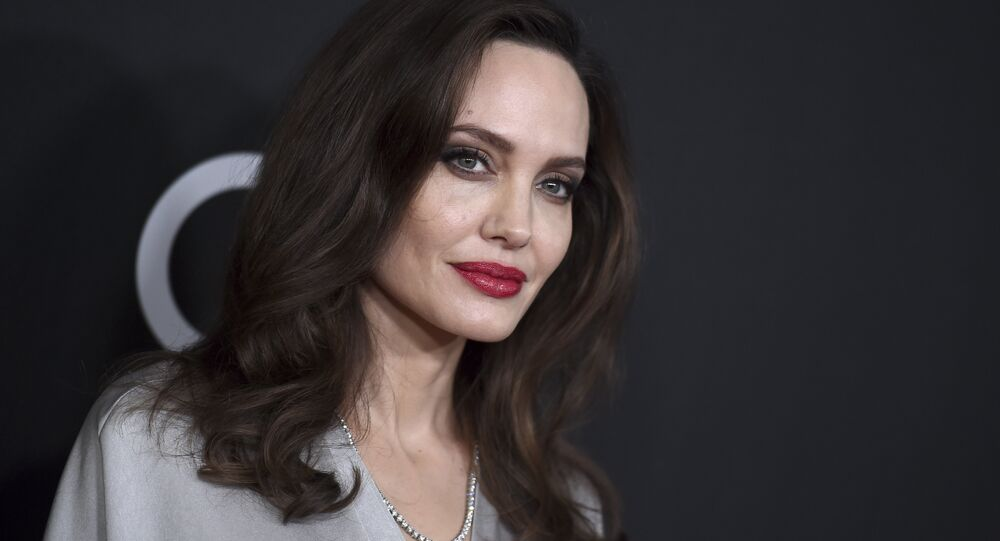 Angelina Jolie arrives at the Hollywood Film Awards at the Beverly Hilton hotel on Sunday, Nov. 5, 2017, in Beverly Hills, Calif