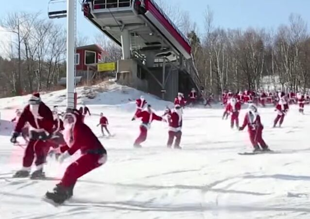 These Santas are Skiing for Presents!