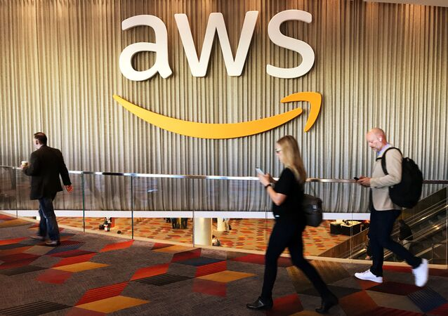 Attendees at Amazon.com Inc annual cloud computing conference walk past the Amazon Web Services logo in Las Vegas, Nevada, U.S., November 30, 2017