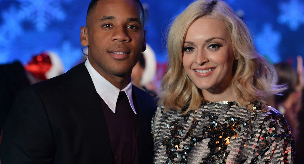 Reggie Yates and Fearne Cotton present BBC 1's Christmas Day Special Top of the Pops in London on Saturday, Dec. 7, 2013.