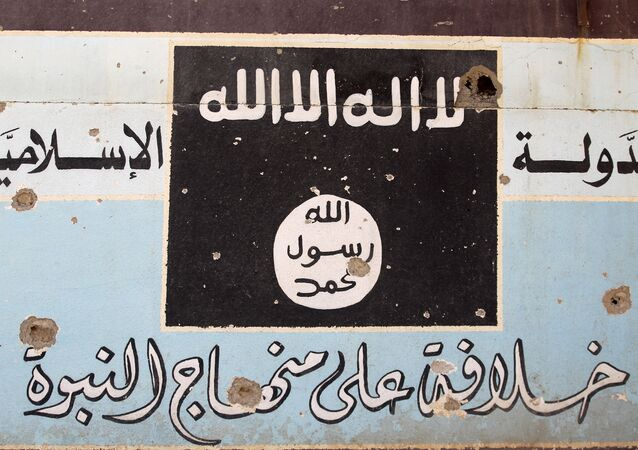 A picture shows a mural depicting the emblem of the Islamic State (IS) group as Iraqi forces, backed by fighters from the Hashed al-Shaabi (Popular Mobilisation units), advance through Hawija on October 5, 2017, after retaking the city from Islamic State (IS) group fighters.