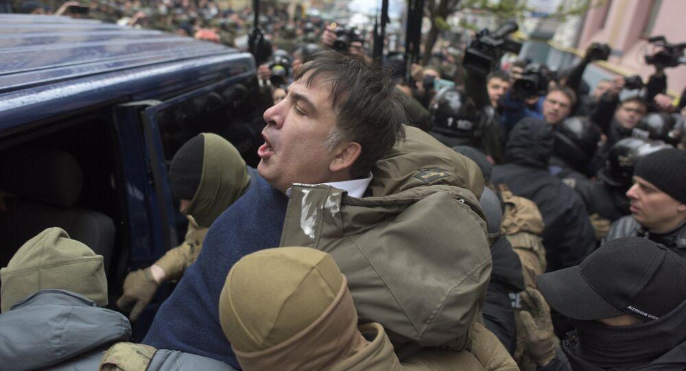 Ukrainian Security Service officers detain Mikheil Saakashvili at his house in Kiev, Ukraine, Tuesday, Dec. 5, 2017