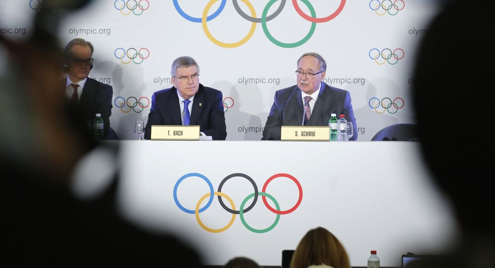 Samuel Schmid, Chair of the IOC Disciplinary Commission, and Thomas Bach, President of the International Olympic Committee, attend a news conference after an Executive Board meeting on sanctions for Russian athletes, in Lausanne, Switzerland, December 5, 2017