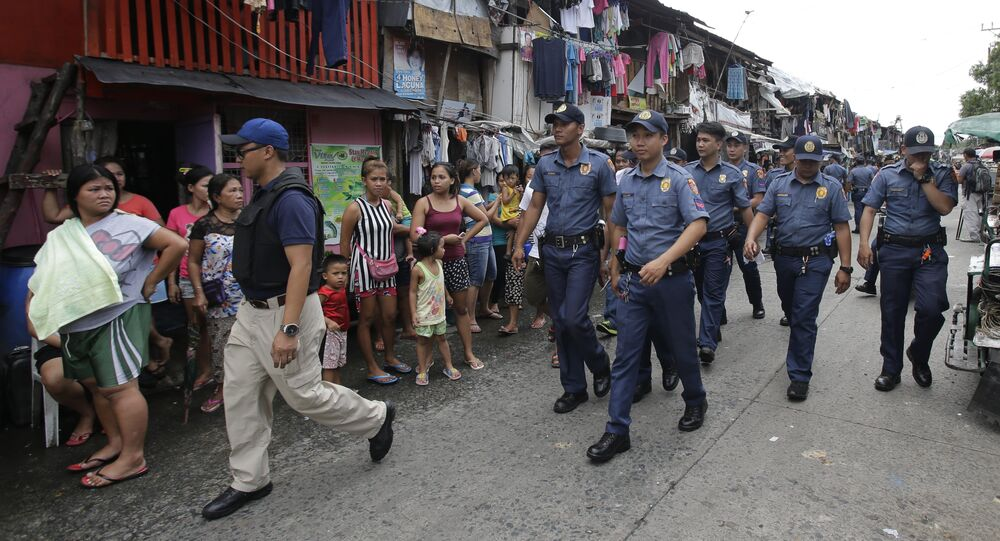 (File) Policemen patrol around a slum area during a police operation as part of the continuing War on Drugs campaign of Philippine President Rodrigo Duterte in Manila, Philippines on Thursday, Oct. 6, 2016