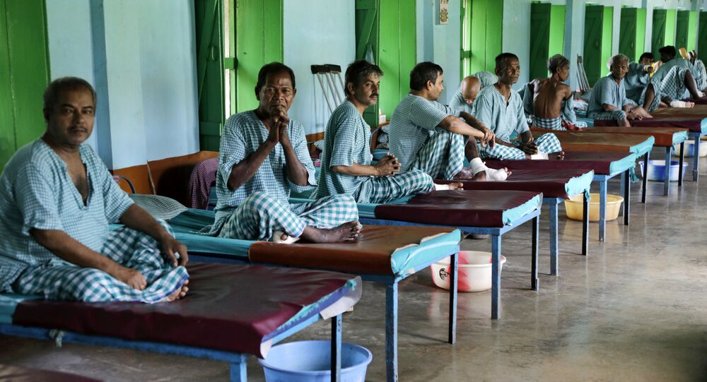 In this Aug. 30, 2016 photo, leprosy patients sit on their beds at Gandhiji Prem Nivas, or Gandhiji House of Love, in Titagarh, north of Kolkata, India