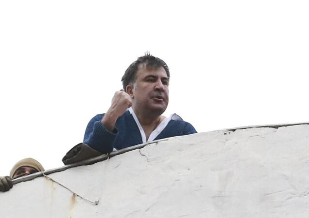 Georgian former President Mikheil Saakashvili is seen on the roof of a building during a search of his apartment in Kiev, Ukraine