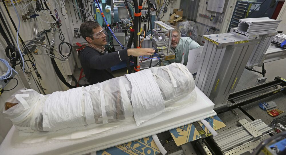Argonne X-ray scientist Jonathan Almer, left, and Northwestern University Feinberg School of Medicine professor Stuart Stock, right, prepare to use high-energy X-ray beams to learn more about the 1,800-year-old mummified remains believed to be a 5-year-old girl in Lemont, Ill