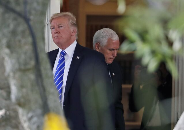 President Donald Trump steps out of the Oval Office, with Vice President Mike Pence behind him, as Trump walks to board Marine One at the White House, Tuesday, Sept. 26, 2017, in Washington