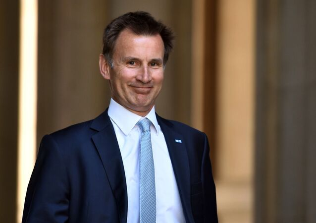 Jeremy Hunt arrives at Downing Street in London, Sunday June 11, 2017.