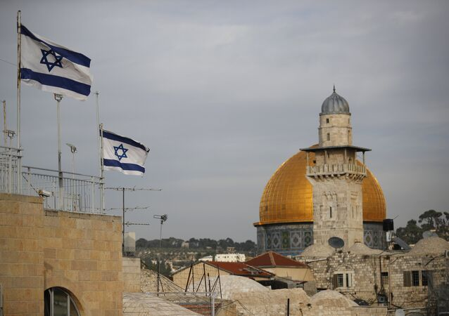 Israeli flags fly near the Dome of the Rock in the Al-Aqsa mosque compound