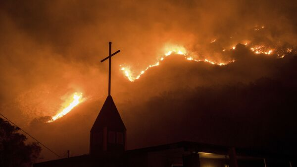 Flames from a wildfire advance down a hillside near the Springs of Life Church in Casitas Springs, Calif., on Tuesday, Dec. 5, 2017. - Sputnik International