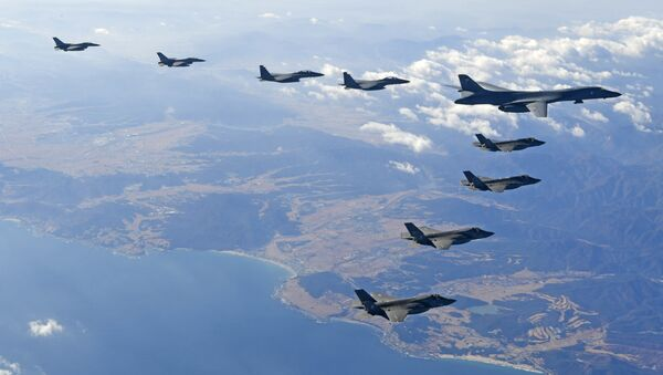 In this photo provided by South Korea Defense Ministry, U.S. Air Force B-1B bomber, right top, flies over the Korean Peninsula with South Korean fighter jets and U.S. fighter jets during the combined aerial exercise, South Korea, Wednesday, Dec. 6, 2017 - Sputnik International