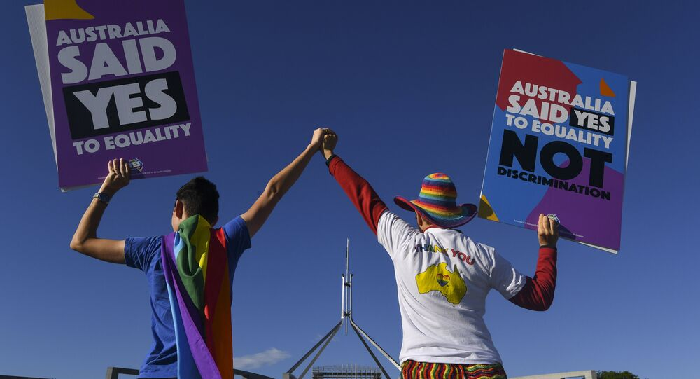 Same-sex marriage campaigners pose for pictures during an equality rally outside Parliament House in Canberra December 7, 2017