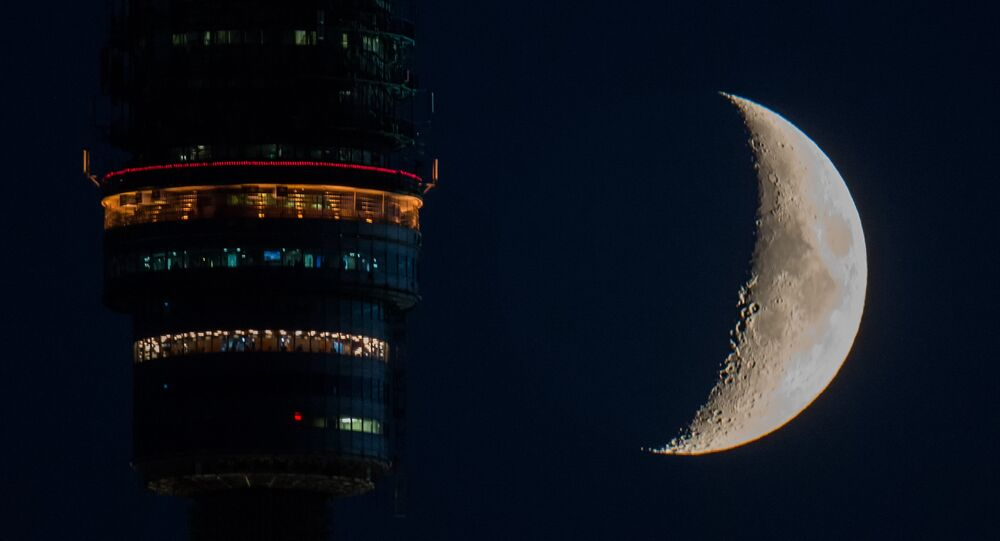 Ostankino TV Tower observation deck and waxing moon in Moscow