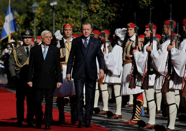 Greek President Prokopis Pavlopoulos and his Turkish counterpart Tayyip Erdogan inspect a guard of honour during a welcome ceremony in Athens, Greece December 7, 2017