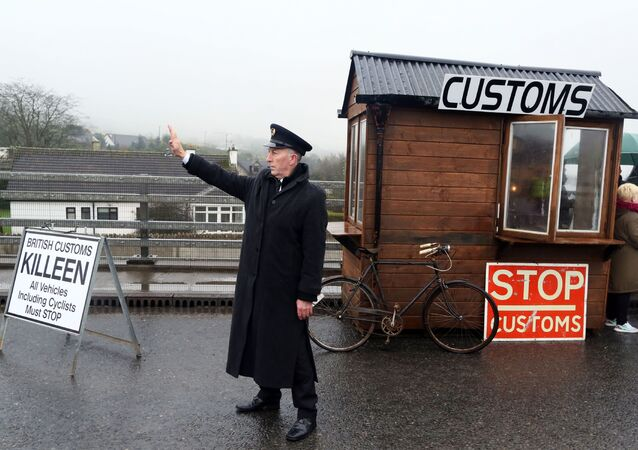 Demonstrators dressed as custom officials set up a mock customs checkpoint at the border crossing in Killeen, near Dundalk to protest against the potential introduction of border checks following the decision by the UK to leave the EU on February 18, 2017