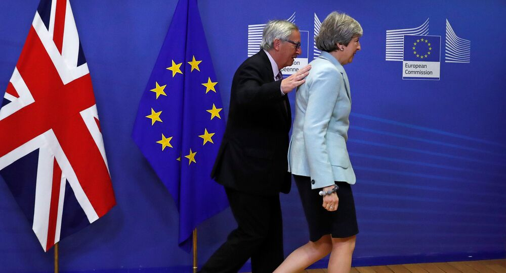 Britain's Prime Minister Theresa May is welcomed by European Commission President Jean-Claude Juncker at the EC headquarters in Brussels, Belgium December 8, 2017
