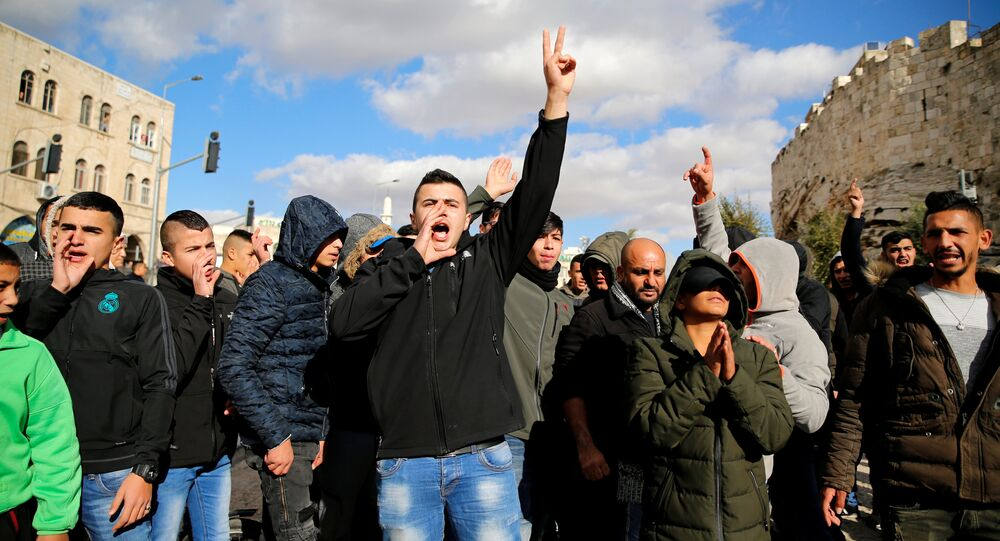 Palestinians shout slogans during a protest following US President Donald Trump's announcement that he has recognized Jerusalem as Israel's capital, near Damascus Gate in Jerusalem's Old City December 7, 2017