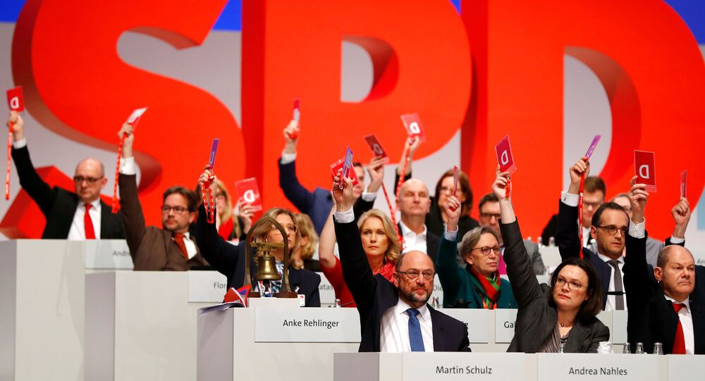 Social Democratic Party (SPD) members vote during an SPD party convention in Berlin, Germany, December 7, 2017