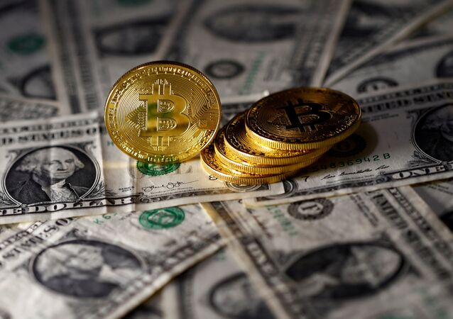 Bitcoin (virtual currency) coins placed on Dollar banknotes are seen in this illustration picture, November 6, 2017