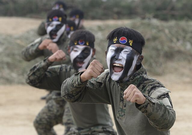 Soldiers of the South Korean army special forces demonstrate their martial art skills during Naktong River Battle re-enactment in Waegwan, South Korea, Thursday, Sept. 22, 2016