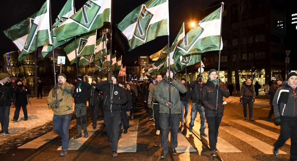 Members of far right group Nordic Resistance Movement march during the festivities of the centenary of Finnish independence in Helsinki, Finland on December 6, 2017