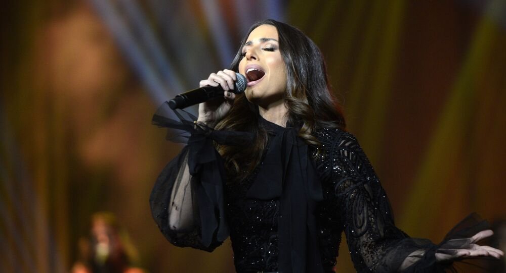 Lebanese singer Hiba Tawaji performing during the first ever female concert in the capital Riyadh at the King Fahd Cultural Center in the Saudi capital Riyadh