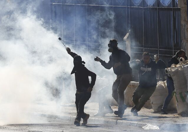 Palestinians clash with Israeli troops during a protest against U.S. President Donald Trump's decision to recognize Jerusalem as the capital of Israel in the West Bank city of Bethlehem, Friday, Dec.8, 2017