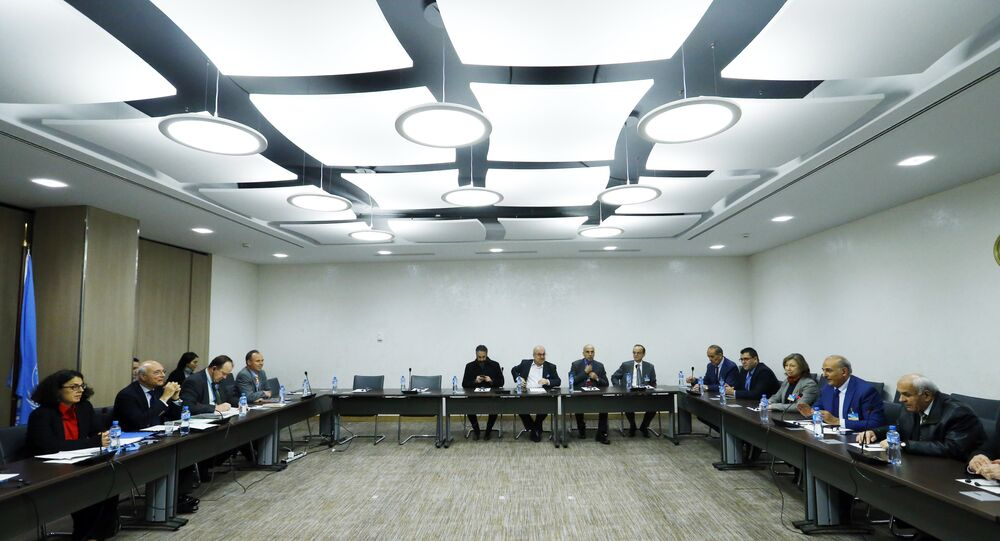 Members of the delegation of the Syrian Negotiation Commission (SNC) attend a meeting with United Nations Deputy Special Envoy for Syria Ramzy Ezzeldin Ramzy during the Intra Syria talks in Geneva, Switzerland