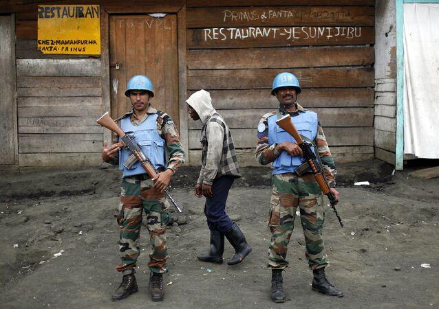 Two UN soldiers stand guard in Goma, Democratic Republic of Congo. (File)