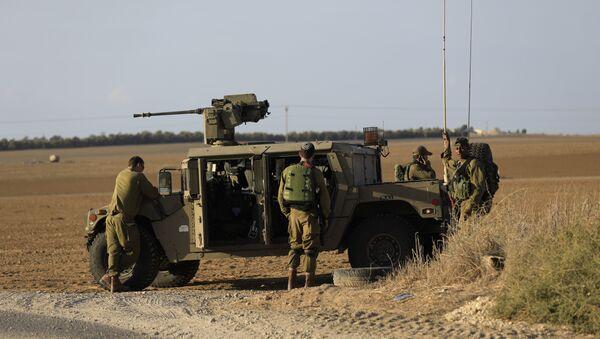 Israeli soldiers stand near the border with Gaza. (File) - Sputnik International