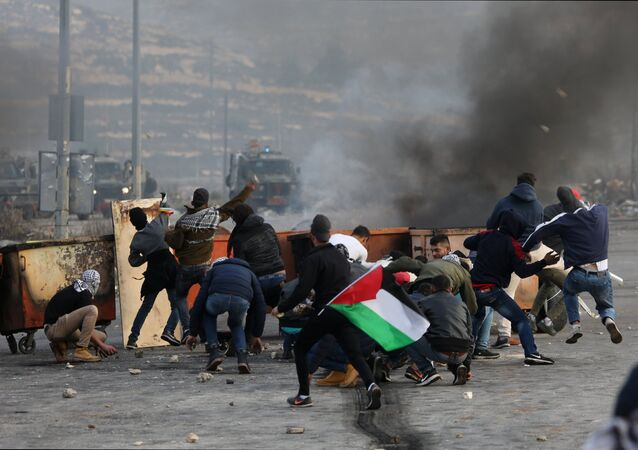 Participants in a protest in Palestine against the decision to recognize Jerusalem as the capital of Israel